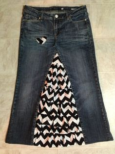 Such a cute blue jean skirt...LOVE the chevron ruffle inserts! Just get rid of that awkward little heart.