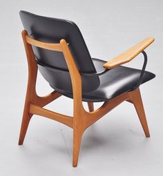 Anonymous; Birch, Enameled Metal and Vinyl Lounge Chair, c1960.