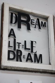 Old window craft. Quote: If you want to you should strike out on new paths, rather than travel the worn paths of accepted success. ~John D. Rockefeller~  With writing that is different sizes with some letters bolded.