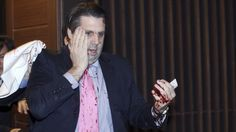 The US ambassador to South Korea, Mark Lippert, is slashed on his face and hand in Seoul by a man demanding Korean reunification.