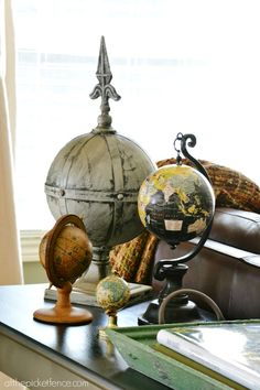 Vintage globe collection from atthepicketfence.com - want to start a globe collection for the den library shelf