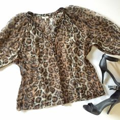 """Joie silk leopard blouse Beautiful semi sheer top by Joie in silk crepe. The fabric/care tag is cut out but it is dry clean only. Buttons halfway down, three quarter length sleeves. Great condition! Measures 22"""" from underarm to underarm and 24"""" long. Joie Tops Blouses"""