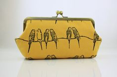This parakeet clutch makes me sing!