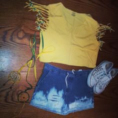 Dip dyed into bleach distressed shorts with a cute yellow v neck hand shredded on the sleeves with Seattle SuperSonics colored beads on the ends. Finish this cure sports themed outfit with studded white converse!!