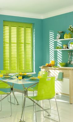 Bring a tropical theme into your home with a mix of greens and blues in bright vivid colours. Made to measure bright green shutters can add the tropical vibe into any kitchen.