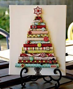 Ever have just a little bit of Gift wrapping paper left and not sure what to do with it   Try making a holiday Tree out of it like this