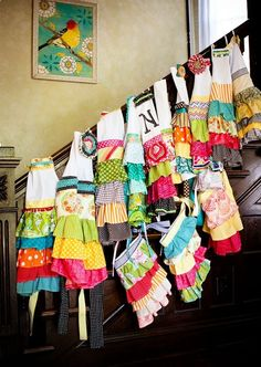 Make your own Apron Party. Even works for little girls. Start with the plain white ones from Hobby Lobby and let the little girls sew on the pre-hemed ruffles...its just a straight line from there! They can add flower pins or iron-ons to the top.