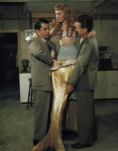 Ann Blyth getting into her tail for Mr. Peabody and the Mermaid