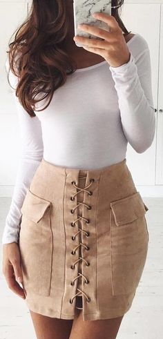 #spring #outfits woman wearing white boat-neck long-sleeved top and brown mini skirt near white wal. Pic by @fashionpossessions
