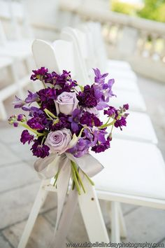 Something in these colors for the bouquets would be great. With grey and white striped ribbon - Purple Wedding aisle decor