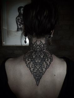 This tat blows my freaking mind. Who says tattoos make you look tough? This is so soft and delicate