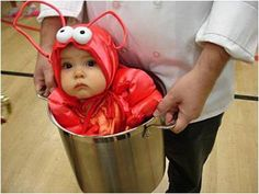 Not only is this an adorable picture but it is an excellent idea for Halloween. That lobster looks delicious; I could nibble on it all day long.