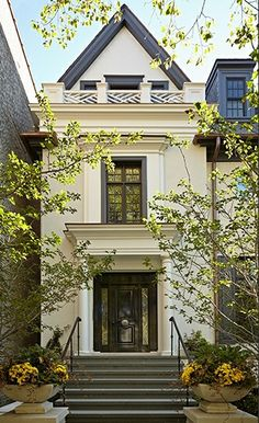 Burns  Beyerl Architects painted brick  limestone house, front facade: Benjamin Moore Navaho White, custom black color