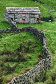 """Swaledale Barn in North Yorkshire, by metriskon flickr.Swaledale is the northernmost dale within the Yorkshire Dales National Park; and considered by many as one of the most beautiful. The photographer here states the entire dale is """"littered with beautiful stone barns and dry stone walls.""""  I love me some stone fences."""