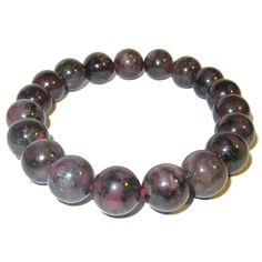 "Tourmaline Bracelet Purple 10 mm Stretch Rare Beautiful Crystal Healing Round Gemstones (Gift Box) (6.5). Measures: 10mm stones. Bracelet Size Chart: x-small: 5""-6"", small: 6""-7"", medium: 7""-8"", large: 8""-9"". Includes: One bracelet in a Satin Crystals gift box (box colors vary). Tourmaline increases spiritual awareness. It is very protective and provides confidence. Deflects electro-magnetic radiation. Attractive precious purple tourmaline is beaded on your new crystal healing stretch..."