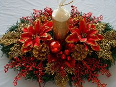 This Christmas Center Piece is gorgeous in Red and Gold. The Holiday Centerpiece measures about 18 inches long and 10 inches wide. This Red and Gold Christmas Centerpiece is Ideal for a Dining Room ta Christmas Floral Arrangements, Christmas Table Centerpieces, Gold Christmas Decorations, Christmas Tablescapes, Christmas Candles, Christmas Crafts, Christmas Ornaments, Holiday Decor, Xmas Wreaths