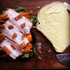 At home ill hungry and have leftover pork belly so made a sandwich for lunch. #lunch #sandwich #ill #hungry #home #pork #leftover #leftovers #carrot #mustard #salad #rocket #crackling #porkbelly #food #meat #foodie #foodpic  #foodpics #gourmet #instapic #instagay #bf #lgbt by playingwfooduk