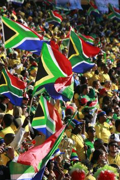 Sports fans waving South African flags.