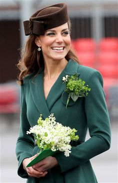 The Duchess dazzled the troops at the St. Patrick's day shamrock ceremony 2012. Catherine wore a green Emilia Wickstead coat with a brown pill box hat.