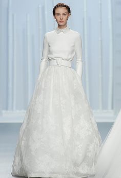 Brides.com: . Long sleeve A-line wedding dress with Peter Pan collar and accent belt, Rosa Clará