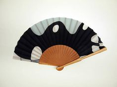 To create this beautiful piece, first I painted the silk and then a hand fan artisan mounted it on a structure of Pear Tree wood. This is a folding fan in black, grey and white colors. The size of this piece makes it perfect to carry in your handbag and use anywhere when its really hot! In