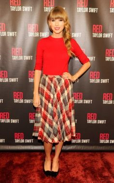 Taylor Swift's plaid skirt and sweater with bows on sleeves