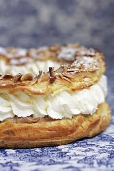 A Paris–Brest is a French dessert, made of choux pastry and a praline flavored cream.