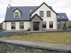 A typical co clare dormer with granite frontage and corner flagstones house designs ireland, bungalow Dormer House, Dormer Bungalow, House Designs Ireland, Houses In Ireland, Bungalow Exterior, Bungalow Renovation, Bungalows, Style At Home, Bungalow Haus Design