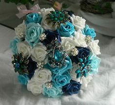do this with real turquoise beads to add color to arrangements if flower choices are too limited. . .Turquoise Wedding Flowers | ... vintage brooch bouquet navy/turquoise white wedding flowers | eBay