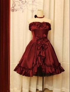 Perfect dress to pair with boots for Xandra's Steampunk arse kicking  from http://www.devilinspired.co.uk/gothic-lolita-dresses/305-gorgeous-bow-gothic-lolita-dress.html