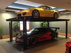 Convert Your Garage into a Man Cave - Man Cave Home Bar Home Car Lift, Garage Car Lift, Garage House, Dream Garage, Car Lifts For Home, Jeep Garage, Prefab Garages, Cool Garages, Custom Garages