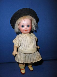 Adorable AM 253 Nobbi Kid Googly doll in original clothing