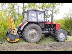 МТЗ-1523-TFS2-200 - многоцелевой трактор 3 т.с. тяги с мульчером 2 м, по...