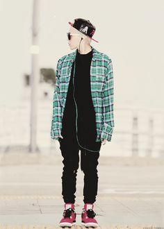 Green plaid shirt, snapback, red shoes, airport fashion
