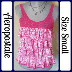 "Sz Small, Aeropostale Tank Top, Ruffles Perfect Condition, Worn 1 time. No wear, tears or stains. Chest measures 16"" across from under arm to under arm, Length is 23"" from shoulder seam to bottom. 60% Cotton, 40% Polyester (T8) Aeropostale Tops Tank Tops"