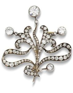 A diamond spray brooch, circa 1890. Of scrolling foliate design set throughout with old brilliant and rose-cut diamonds and accented with collet-set old brilliant-cut diamond finials, mounted in silver and gold, diamonds, Austro-Hungarian assay mark, detachable brooch fitting, fitted case by V. Mayer's Söhne, Wien.