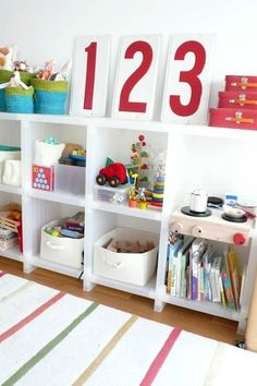 """playroom: bookshelf styling.  This caption cracked me up...isn't it not a playroom if you have to """"style"""" the bookshelves!?"""