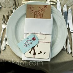 A blue tag and bakers twine wrap up the napkin and menu card for a nice presentation.
