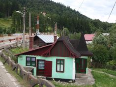 Intriguing green 'witches' hut in Busteni, Romania.