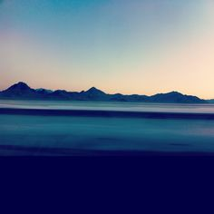 Hello! We are still settling in and I am happy to have access to the internet again. I took this shot with my phone while driving 75 mph from UT to CA by the salt flats at the crack of dawn. I love to take moving road trip photos, you can see other tripshere.
