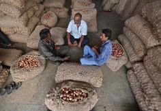 Traders sit amidst stacked sacks, filled with onions and potatoes, at a wholesale vegetable market in Ahmedabad Food Security, Grow Your Own Food, Food Waste, Zero Waste, Sacks, Ahmedabad, Organizations, Documentary, Onions