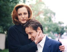 """""""A sweet candid moment between Gillian (Scully) and David (Fox) on the set."""""""
