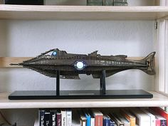 "In early 2004, the Disney Store released a limited edition of 1000 resin Nautilus display replicas. I was one of the lucky few who bought one during that week before they sold out. While not large enough for extreme detail (it's 21"" long), the overall shape and features make it the most accurate Nautilus model ever sold commercially. From the waterline and down it is based on the 11' shooting model and from the waterline and up it is patterned after the ""full scale"" deck set."