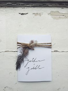 "Hosting Thanksgiving this year? Become the hostess with the mostest and ensure your guests have something to look forward to by sending them these adorably festive DIY invitations. A few weeks before Thanksgiving, invite your guests to ""gather and gobble"" at your house. All you need is white card stock, black calligraphy pens, twine, feathers, and a little love. http://simplystunningspaces.com/"
