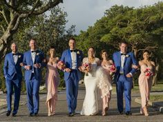 Bridal party colour themes: Blue and blush (baby pink) bridal party: Bride wears a customised Pronovias Bitan gown with three- quarter-length sleeves; bridesmaids in blush (baby pink) strapless dresses and groom and groomsmen in blue suits #weddings #bride #groom