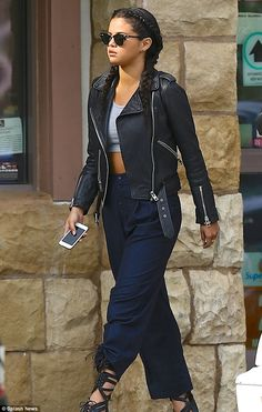 Edgy: The 22-year-old flashed some skin by wearing a grey crop top which bared her taut tu...