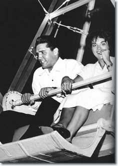 Elvis Presley & Anita Wood July 11, 1960. July 11, Rock and roll king Elvis Presley hugged singer Anita Wood close early yesterday on a clinging  ride called 'The Rocket'  at the FairgroundsAmusement Park in an after-midnight fun spree. Elvis rented the park from 1 a.m. to 5 a.m. and invited about 75 friends to help him kick up his heels.