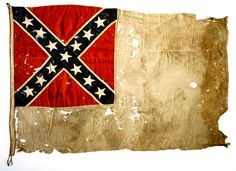 """A native of Lincolnton, North Carolina, General Robert F. Hoke rose to the rank of major general during the Civil War. This is a second national pattern Confederate flag adopted on May 1, 1863 and used until replaced on March 4, 1865. Because of its large white field this pattern flag was nicknamed the """"stainless banner."""" This flag most certainly marked Hoke's headquarters during his brilliant victory at Plymouth, North Carolina on April 20, 1864. This flag was donated to the state sometime afte"""