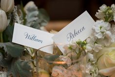 ann whittington events elegant rehearsal dinner southern style country club white escort cards place cards with blue calligraphy