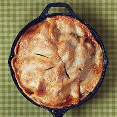 Easy Skillet Apple Pie | Making an apple pie has never been so easy. Simply toss apples, cinnamon, and brown sugar, and spoon over a refrigerated pie crust in the cast-iron skillet. Top with the other crust and bake.